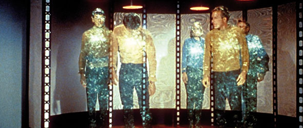 The 'away team' teleporting on/off the Enterprise (Image: CBS Paramount)