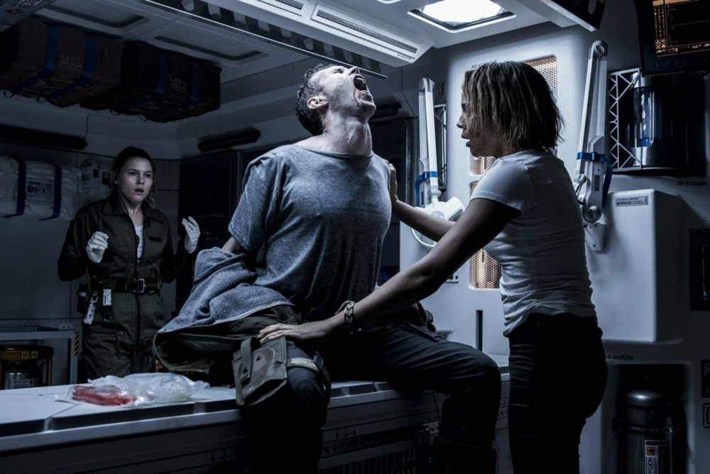 I think there's something wrong with me: Tess Haubrich and Carmen Ejogo inspect Benjamin Rigby (Image: 20th Century Fox)