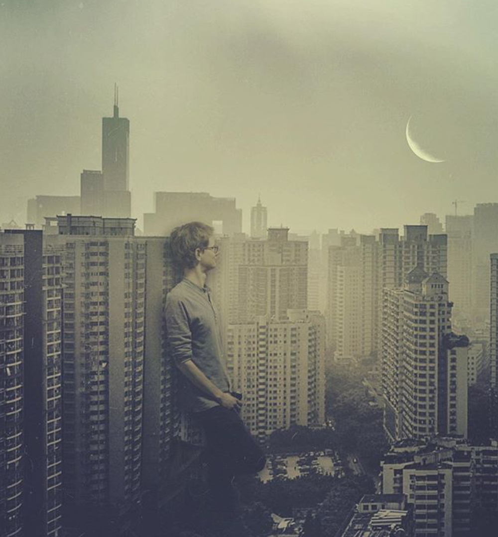 Babel-moon-Man-amidst-building.jpg