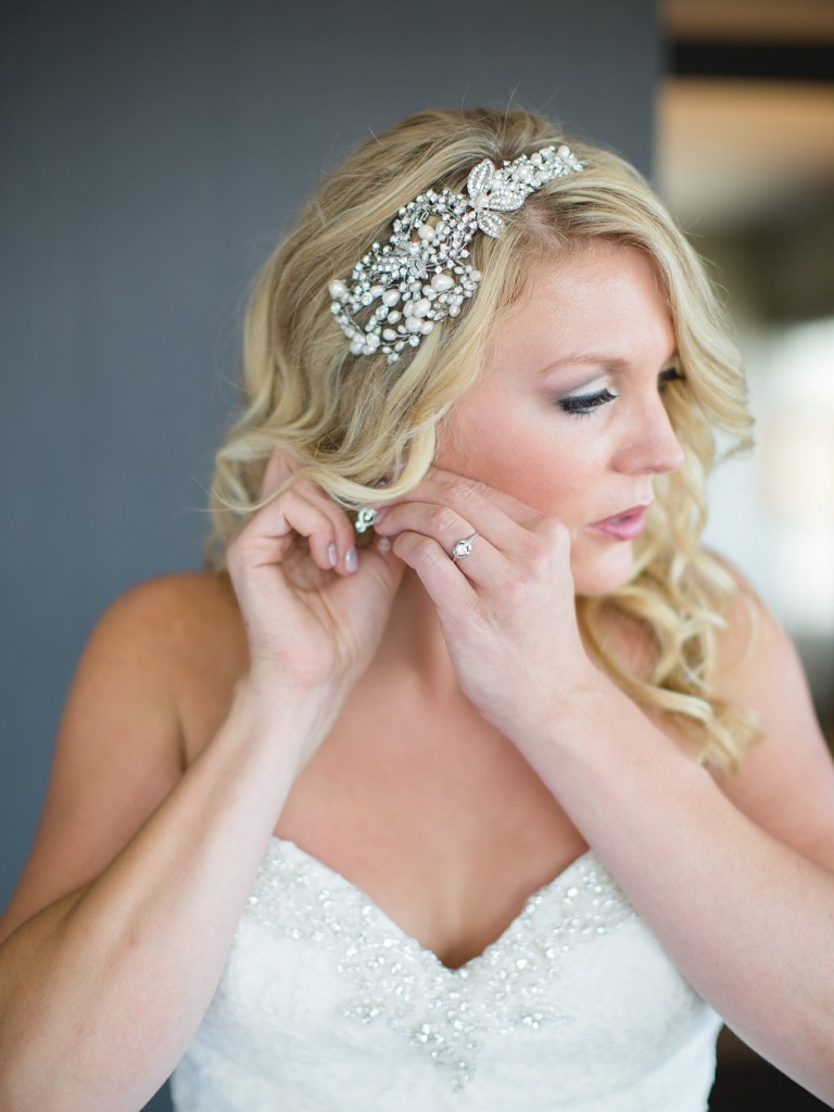 bride putting on earrings, , Rochelle Louise Photography