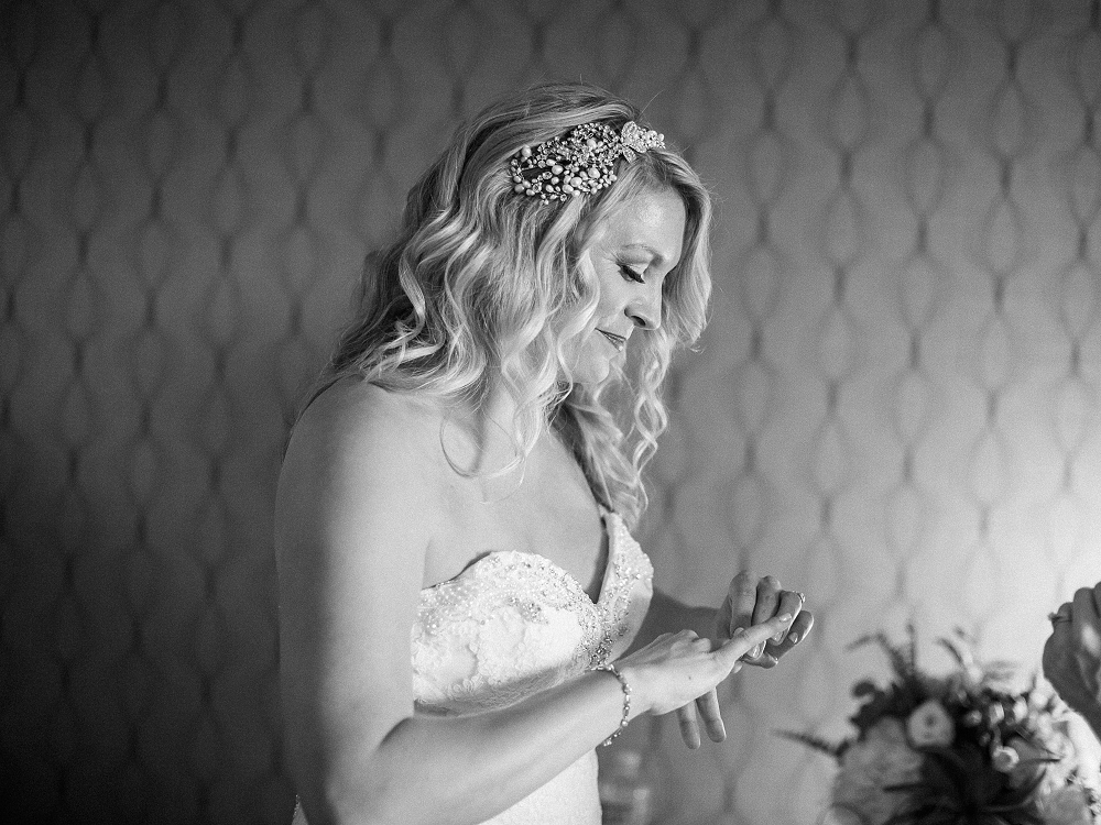 bride putting on jewelry, , Rochelle Louise Photography