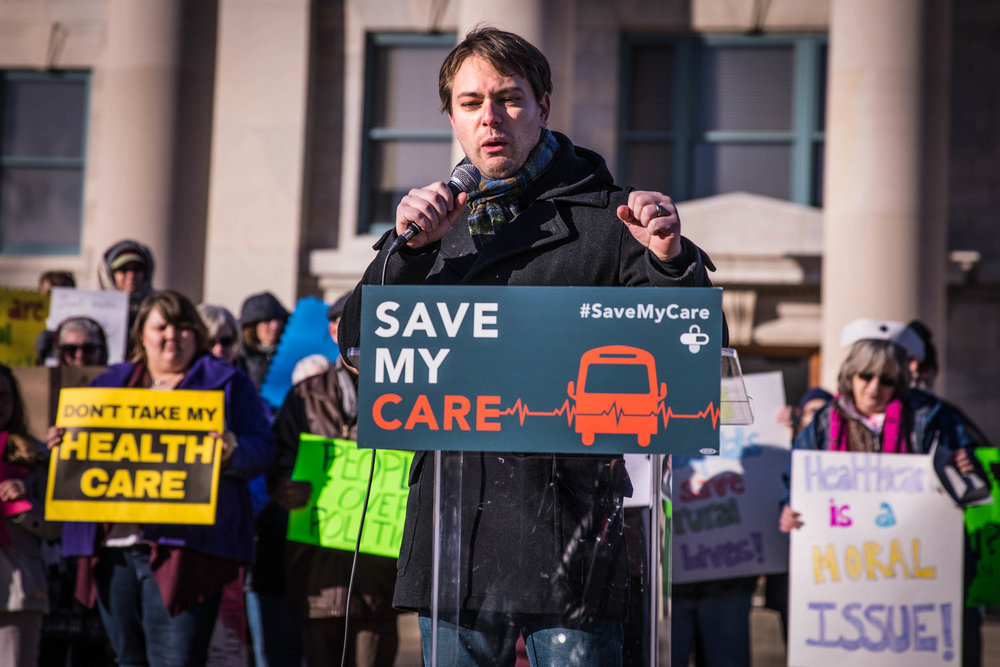 "Scott Fines, Columbia resident, shares his story about his son's pre-existing condition at the Columbia Health Care Bus Rally on Friday, Feb. 3, 2017, in Columbia, Missouri. Fines spoke passionately about the Affordable Care Act. ""This is our family, are we going to give up? No!"" Fines said. Photo by Meiying Wu."