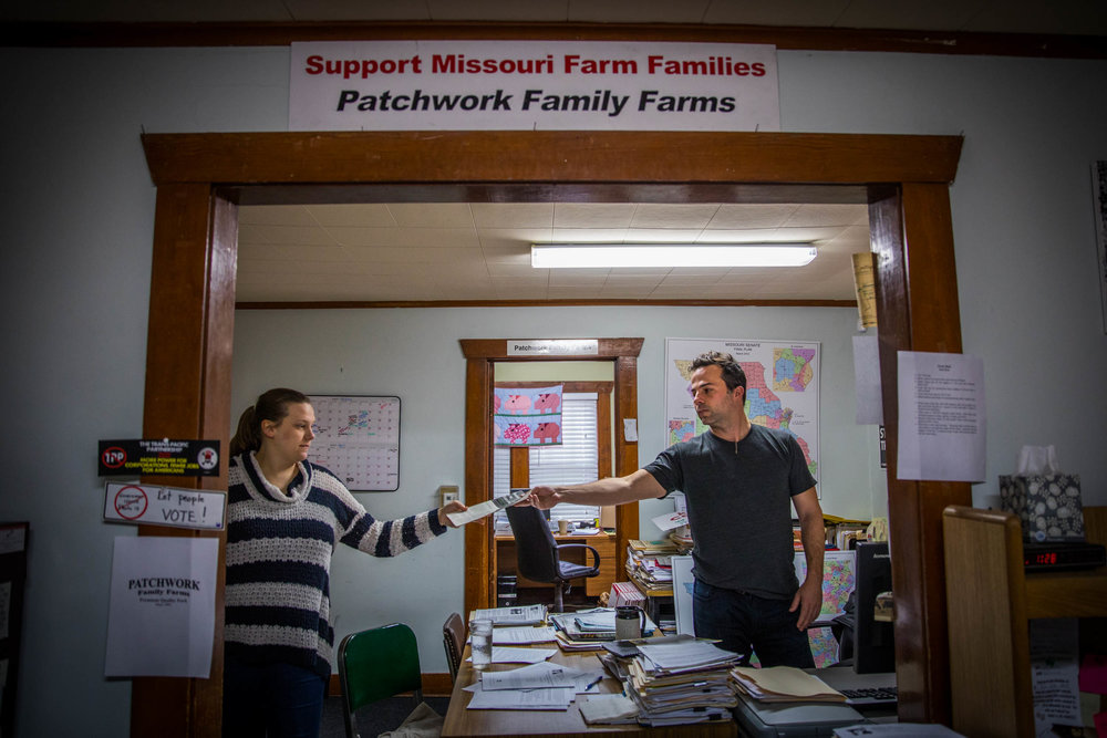 Tim Gibbons, communications director at the Missouri Rural Crisis Center, hands Dina Van Der Zalm, health care organizer at the Missouri Rural Crisis Center, paperwork on Tuesday, Feb. 7, 2017, in Columbia, Missouri. Gibbons and Van Der Zalm lobbied to Missouri legislators to expand Medicaid coverage. Photo by Meiying Wu.