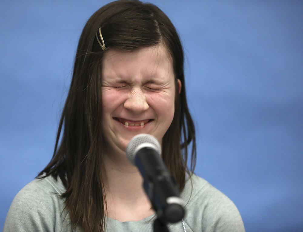 "Emily Berneking, a sixth-grader in Columbia Independent Schools, smiles when the pronouncer reads the definition of ""bezoar"" at the Regional Scripps Spelling Bee in Fisher Auditorium, Gannett Hall on Tuesday, March 13, 2018. Berneking spelled the word incorrectly."