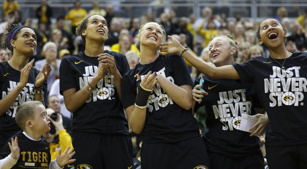 Looking up at the jumbotron, Missouri women's basketball players cheer as Sophie Cunningham, center, is recognized as one of five finalists for the 2018 Cheryl Miller Award during the Tigers' NCAA Tournament Selection Show watch party Monday at Mizzou Arena.