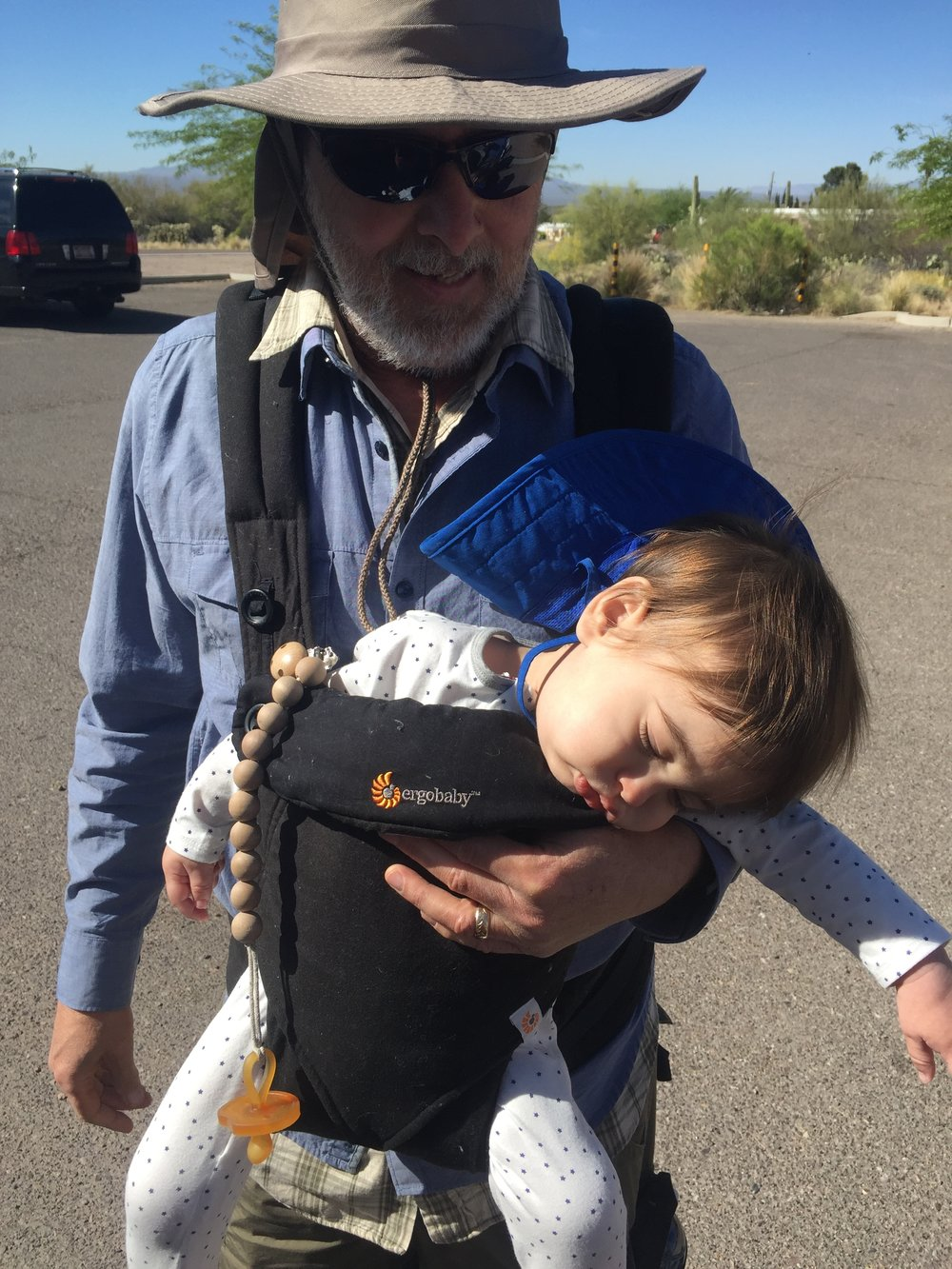 Ollie falling asleep on great-grandpa during our hike!