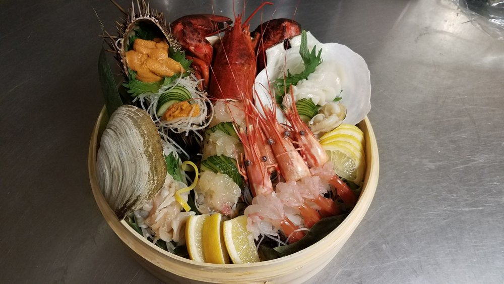 A Pot of Exotic Live Seafood Sashimi - A retail value of $300