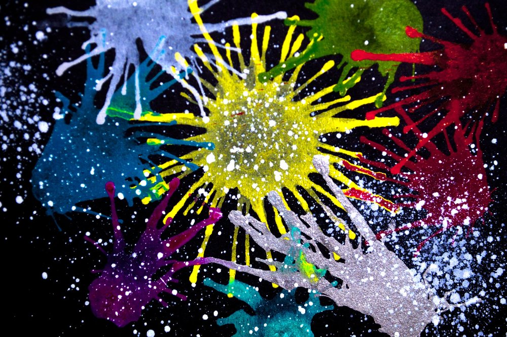 Splatter of Graphik On Black Paper Close .jpg
