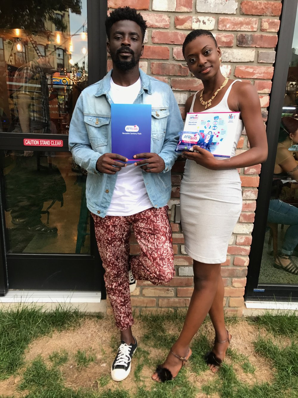 Sam Desalu, founder of Desalu Naturals & Jennifer Abu, founder of WACRIA holding AFRIpads which are reusable sanitary pads designed to provide superior feminine hygiene protection and comfort.  -