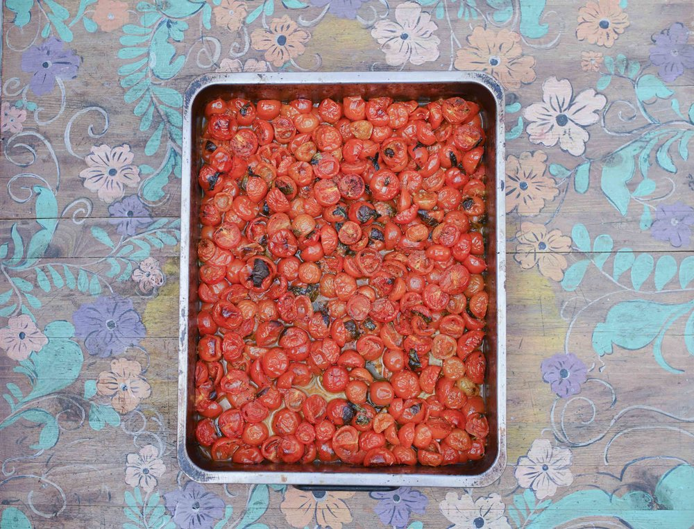 Slow roasted tomatoes nuzzled together.