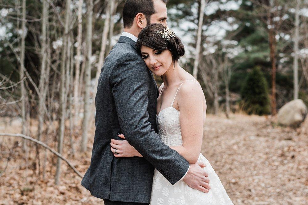 bride and groom hugging wedding photo