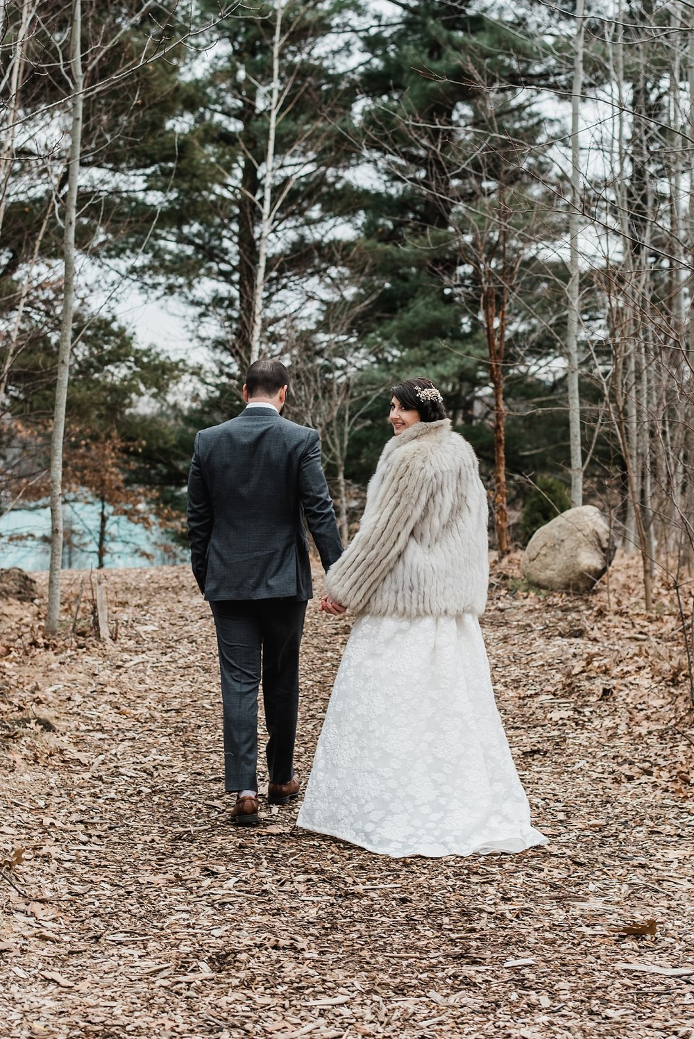 bride and groom walking together photo