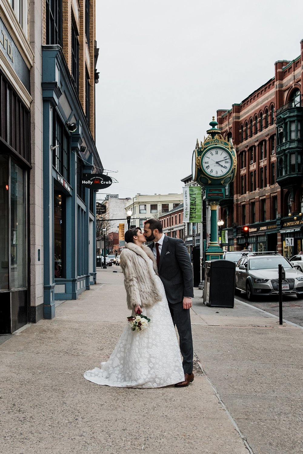 bride and groom kiss downtown lowell