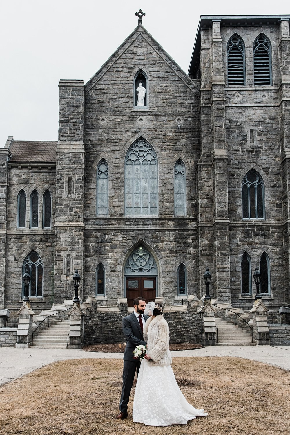 wedding photo in front of immaculate conception church lowell