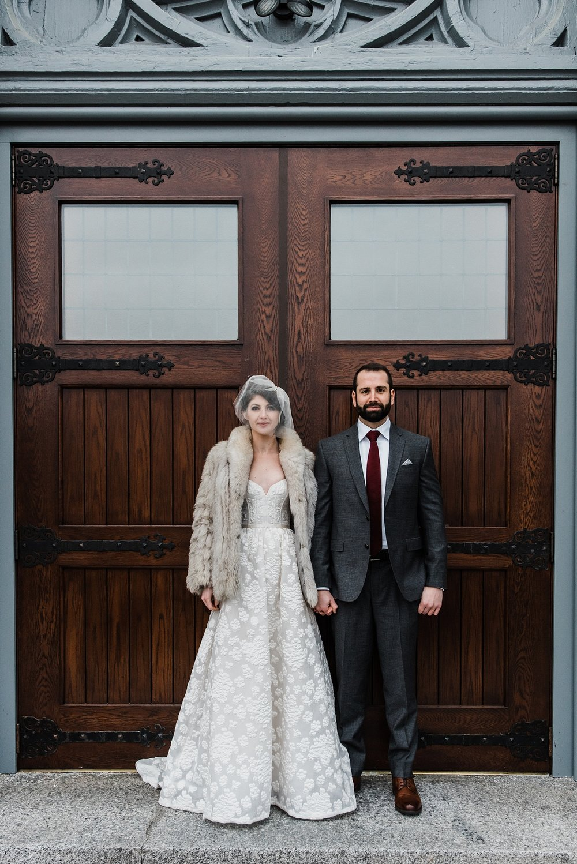 wedding photo in front of chapel doors