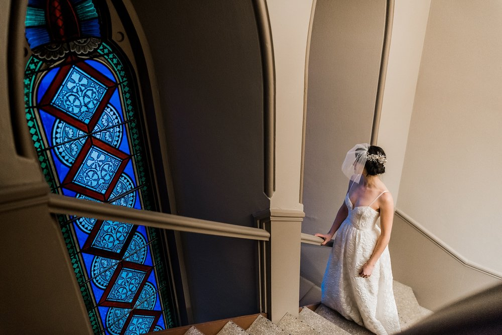 bride looking out window of church