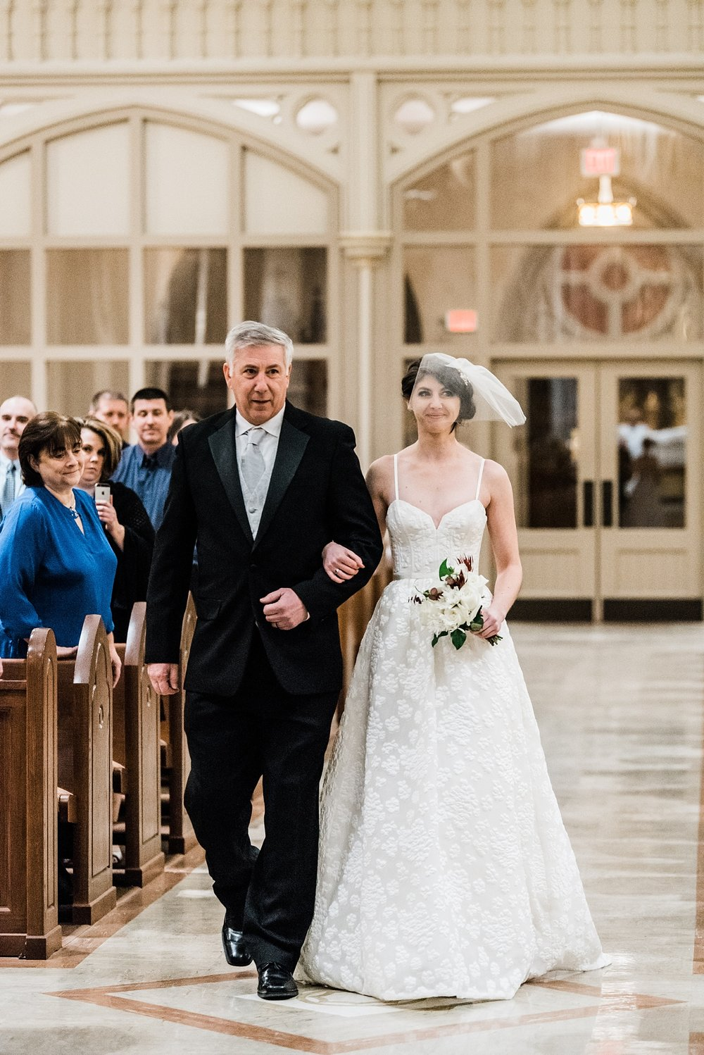 bride walking down aisle with father wedding photo