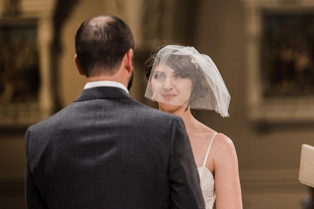 bride smiling at groom wedding ceremony