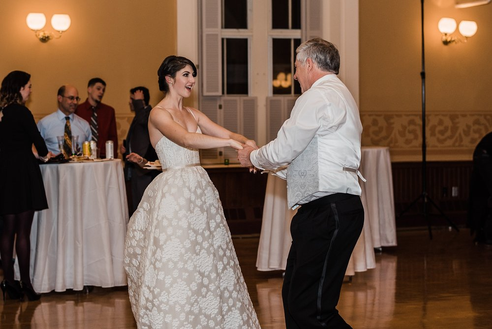father and bride laugh during dance