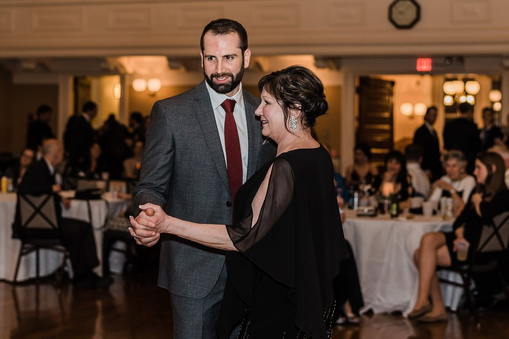 mother and groom laugh during wedding reception dance