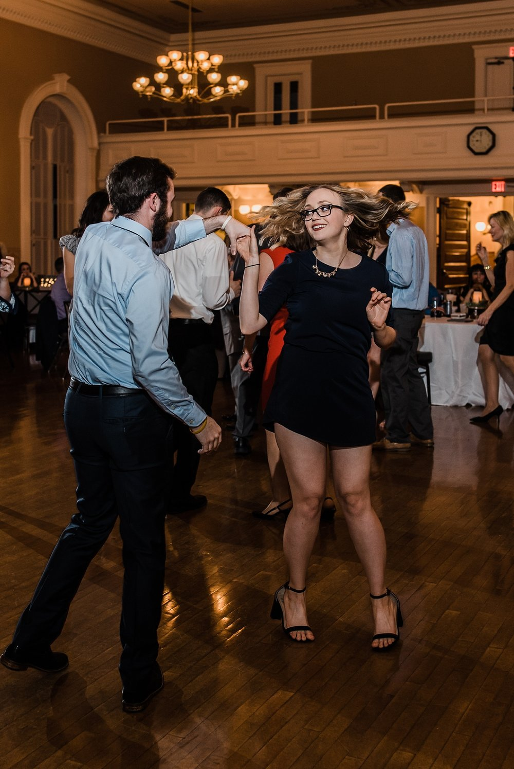 couple spin during wedding reception
