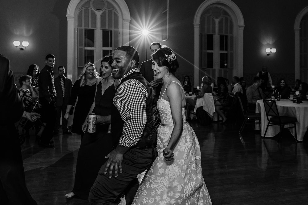 bride and guest dance during wedding reception photo