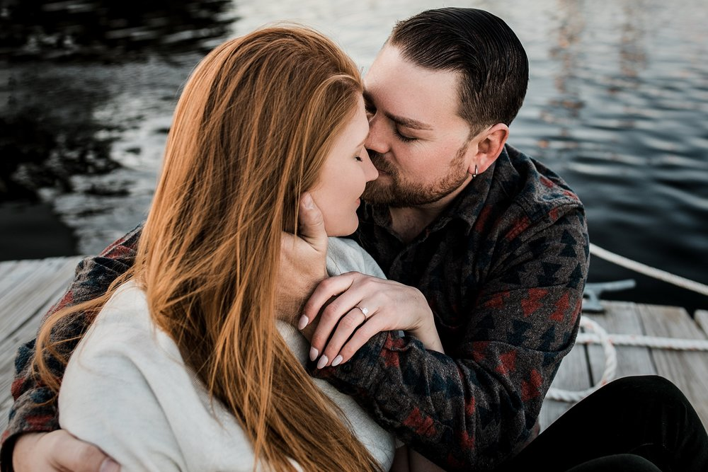 intimate engagement photo on the water
