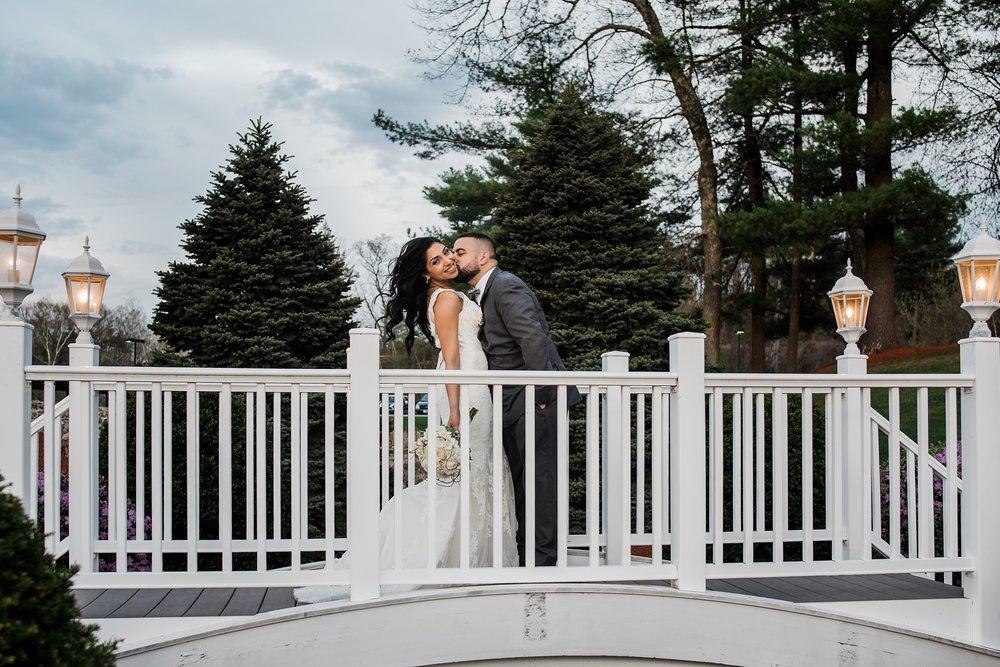 groom kisses bride wedding day