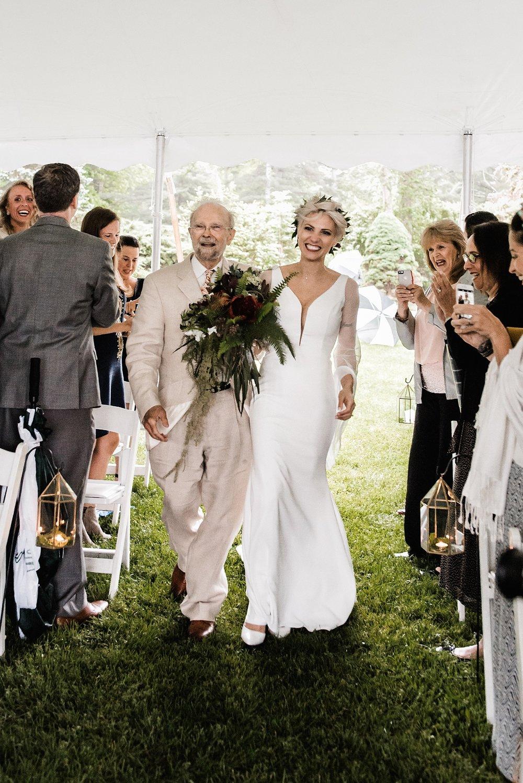 bride coming down aisle