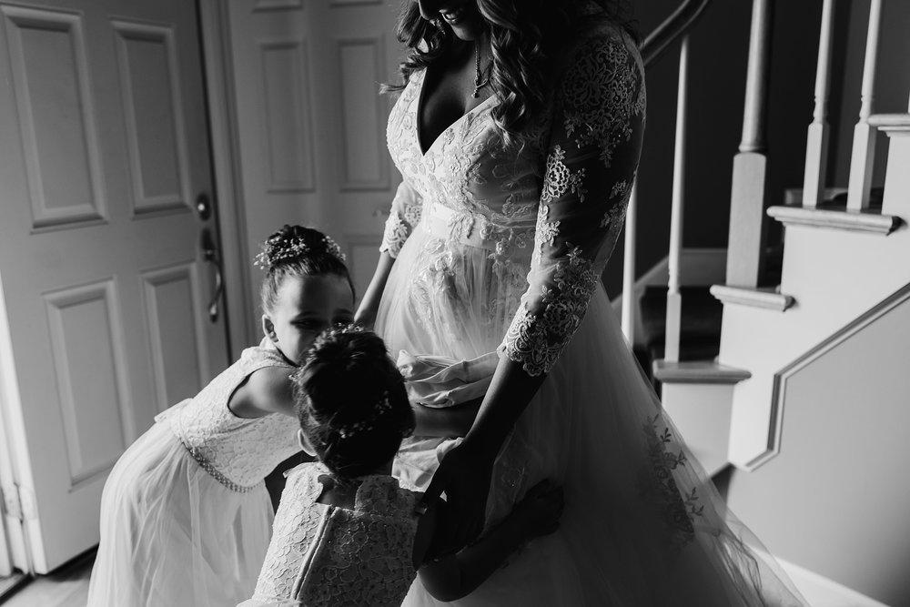 bride and flower girls hug