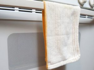 Nice white dish towels that match the kitchen colors.
