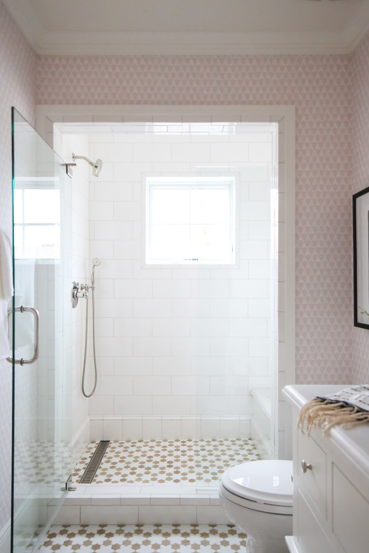 Have fun with tile and wallpaper in your bathroom.
