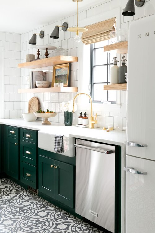Pair a vibrant cabinet color with a classic white backsplash tile and funky floor tile to create a fun yet classic kitchen.