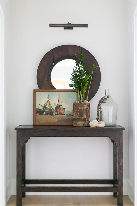 Create an unexpected nook by styling a small console table and adding a wall sconce above.