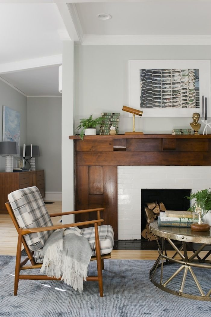 Make your fireplace a focal point. Update it with some pretty tile and be sure to and some art and greenery to help style your mantel.