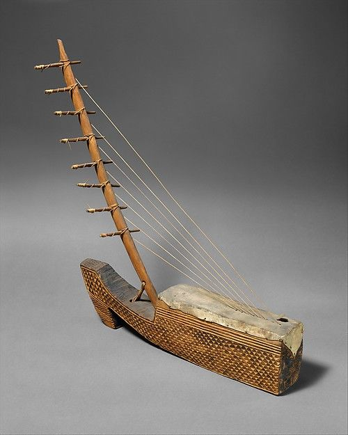 A Ngombi (arched harp) from the Fang/Kele people of Gabon.