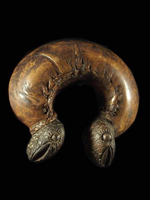 A rattle bracelet from Cameroon or Chad. Clay covered with leather. This has balls within it that as you shake it around it rattles.