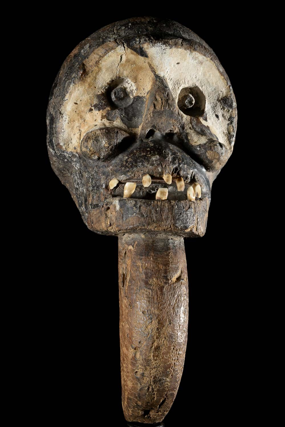A monkey-head   scepter of the Bulu of Cameroon. Ca. 1950. Height: 12.5 in (32 cm).