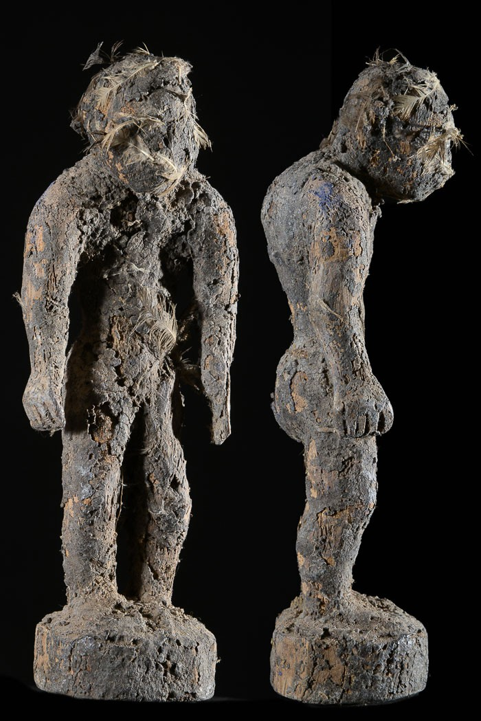 "A voodoo fetish doll (bocio). The bocio is kept in the home in a shelter covered in palm leaves. It is ""fed"" by pouring animal blood and palm wine on it. It serves as a sentinel watching over a house, clan, village, secret society or individual. Height: 10 in (25 cm). Fon tribe, Benin."