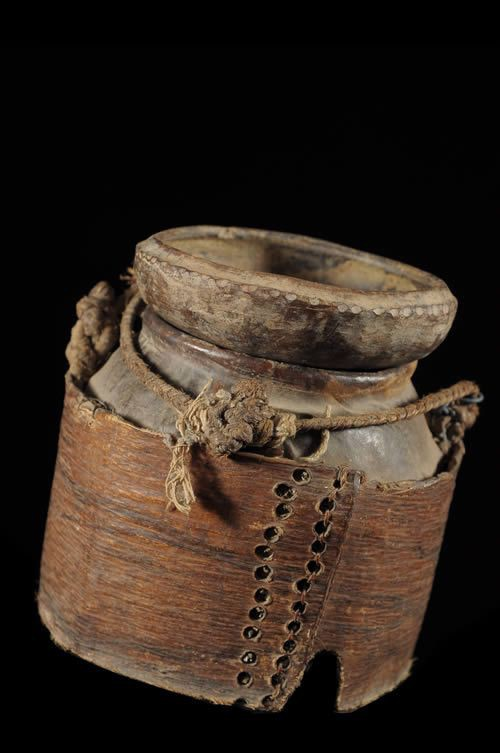 A Guro mouse box for divination. Inside, a horizontal panel with a hole divided the box. Hungry mice were put into the bottom section and during divination they climbed through the hole and ate food in the top section which moved around little objects like turtle shells, porcupine needles, batons, etc. The position in which these objects were found provided the oracle. From Yamoussoukro, Ivory Coast, 1950s.