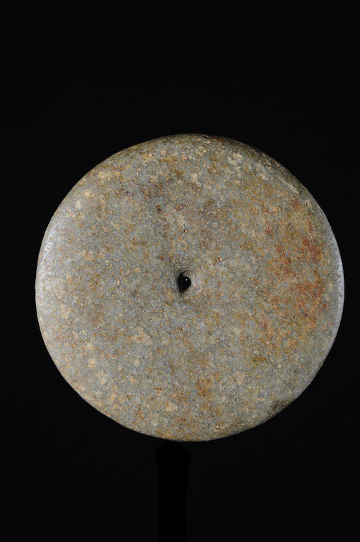 A polished disk found in the Ténéré desert at Niamey, Niger. The purpose is unknown but it has signs of use. It could be the upper part of a millstone used for grinding. Diameter: 61 in (155 cm). Thickness: 6 in (15 cm). Early Neolithic (10,000-8,000 BC).