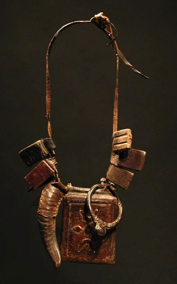 A talisman necklace of the Fulani people. Leather and metal.