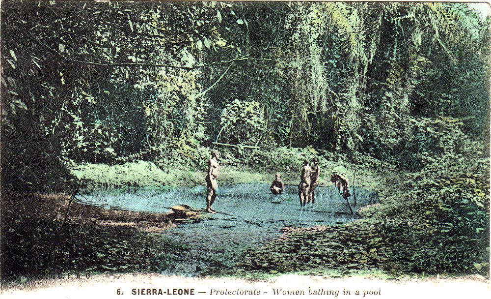 Women bathing in a pool in Sierra Leone.