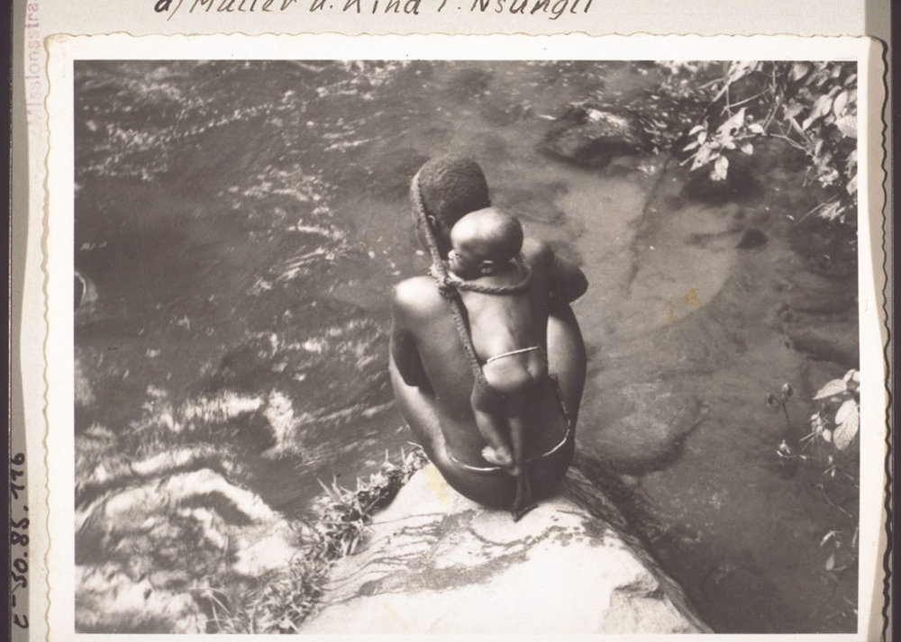 A mother taking her child to bathe. Cameroon, early 1930s.