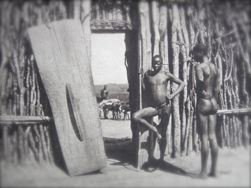 Boma man and his front door, among the Legbaru, Belgian Congo, 1930.