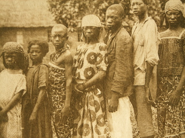 Photo of a family taken by missionaries of Saint-Coeur at the Coquilhatville mission, Belgian Congo.