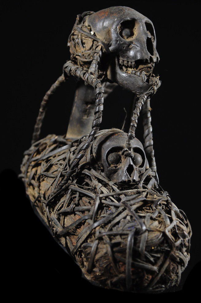 A hunter's basket of the Bulu tribe of Cameroon, adorned with monkey skulls and carrying charms of the  ngil  ritual. Height: 13.7 inches (35 cm).