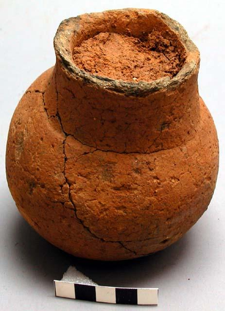 Ceramic vessel filled with clay, found in Harbel hills, Liberia. Measurements: 12.5 x 12.5 x 11 cm (4 15/16 x 4 15/16 x 4 5/16 in).