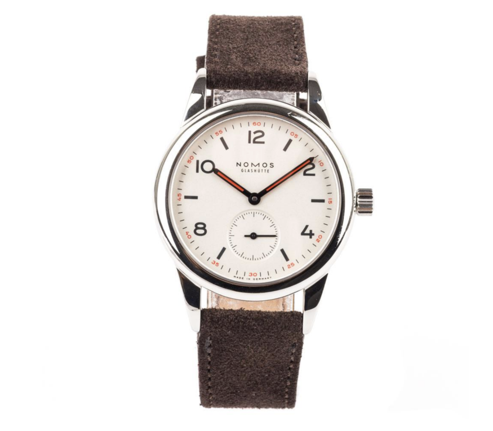 NOMOS GLASHUTTE CLUB TIMEPIECE  - STORE 5aCrafted in stainless steel, this pre-owned Nomas timepiece is designed with a silver plated dial in a 36mm case. The brown, alleriegoshutzt strap is perfect for those that prefer the lightweight comfortable fit.image: store5a.com