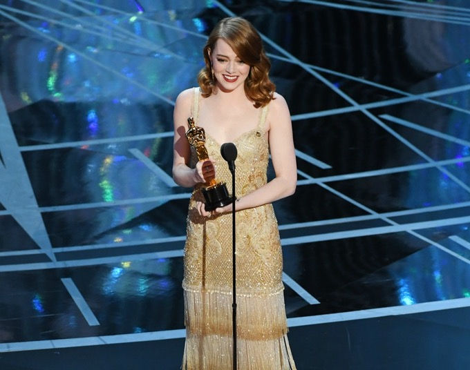 Emma Stone accepting her award for Best Actress in a Leading Role.